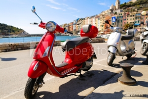 Picture of Red Vespa in the city