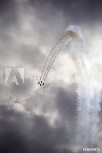 Picture of Low angle view of airshow in cloudy sky